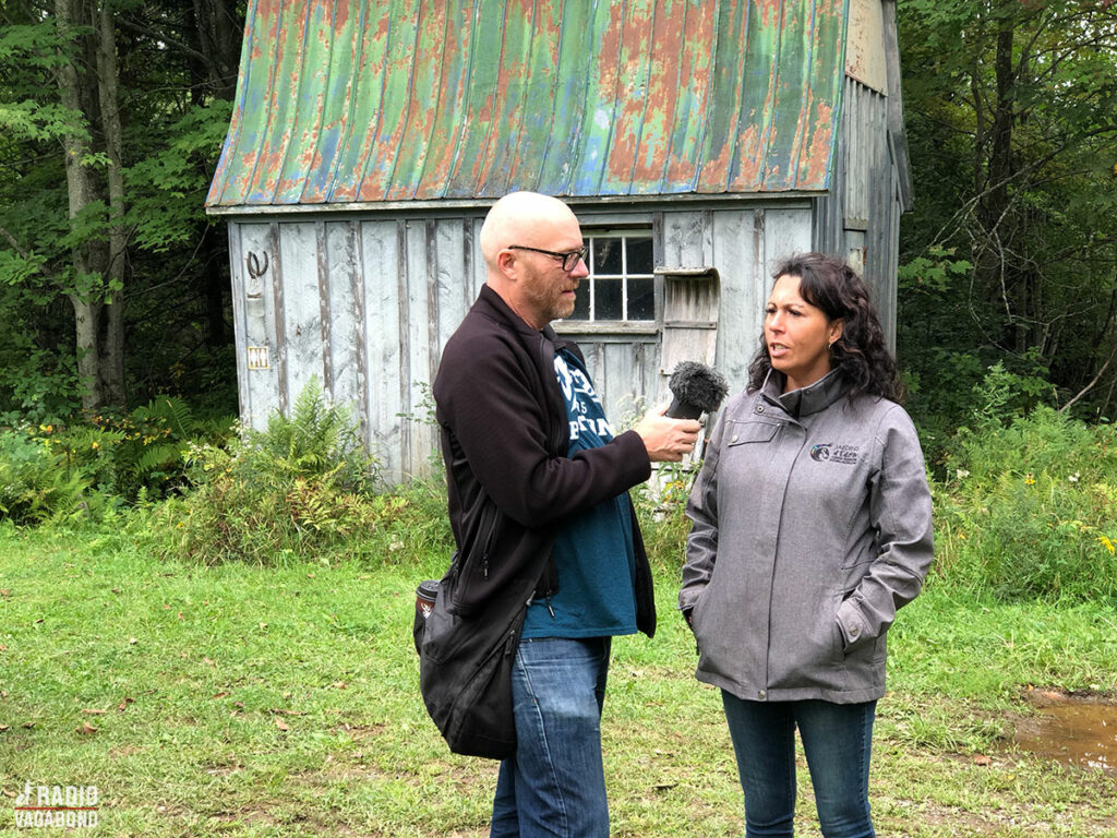Patricia tells me about the Sugar Shack (behind us)