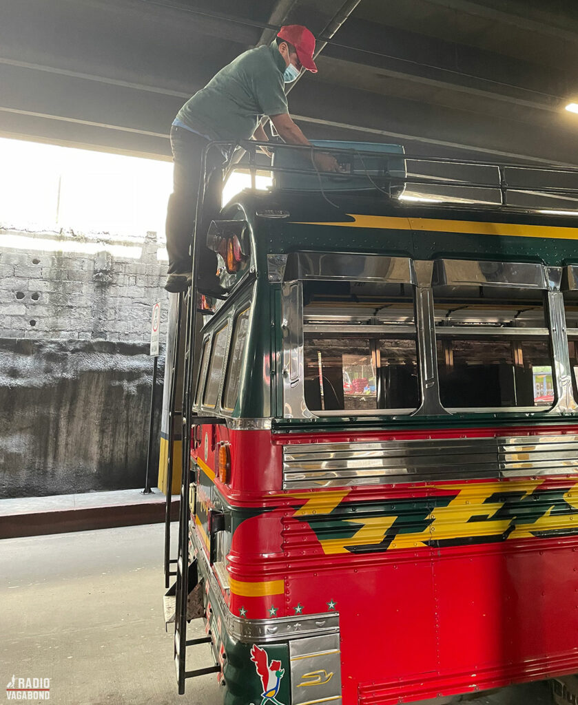 He picked up my heavy suitcase and climbed up on the roof of the bus in Guatemala City